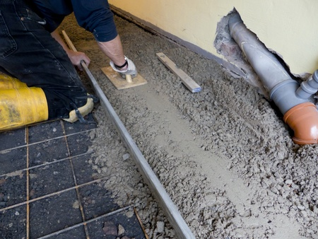 Cement is removed with rail and trowel  photo