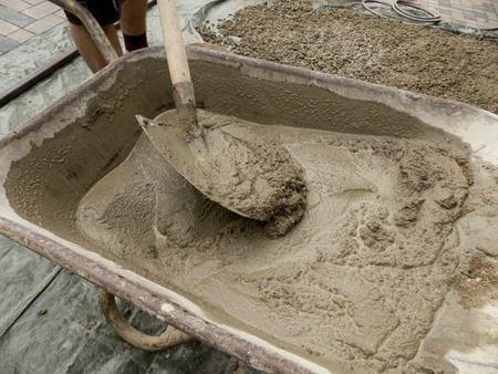 Cement is mixed in a wheelbarrow