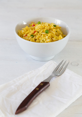 Curry Rice in a bowl on white wooden table photo