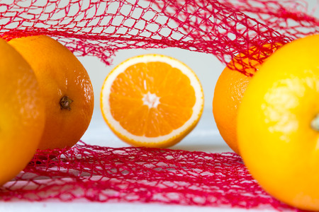 Oranges on a wooden table in the network photo