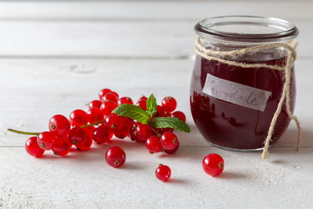 Currant jam in a jar with cord photo