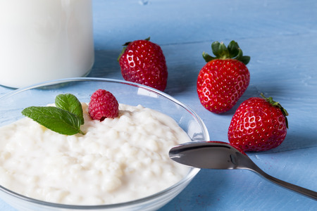 Rice pudding with mint and fruit photo