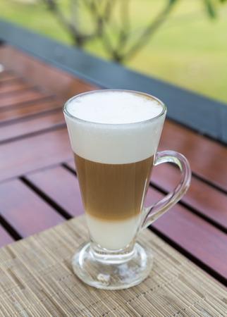 foaming: Latte macchiato in a glass with milk froth.