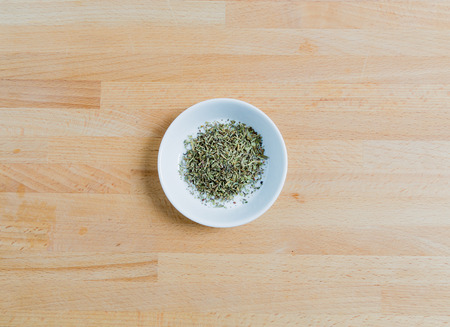 herbs de provence: Provencal herbs in a bowl on wood.