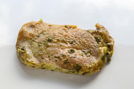marinade: Grill steak rare isolated in marinade. Stock Photo