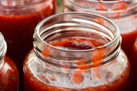 Strawberry jam in a jar macro  photo