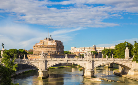 Castel SantAngelo with bridge by day and blue sky.
