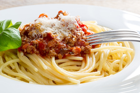 Spaghetti with Bolognese Sauce Parmesan and basil. photo