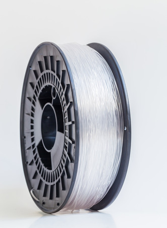 filament: Filament for 3D Printer crystal clear bright background.