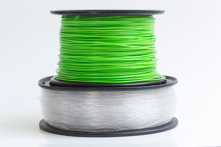 pva: Filament for 3D Printer crystal clear and bright green against a bright background. Stock Photo