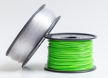 Filament for 3D Printer crystal clear and bright green against a bright background. 版權商用圖片