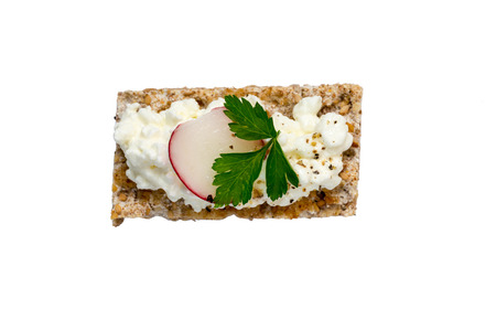 crispbread: Crispbread Isolated with cottage cheese radishes and chives.