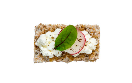 crispbread: Crispbread with cottage cheese radishes and beetroot leaf isolated.