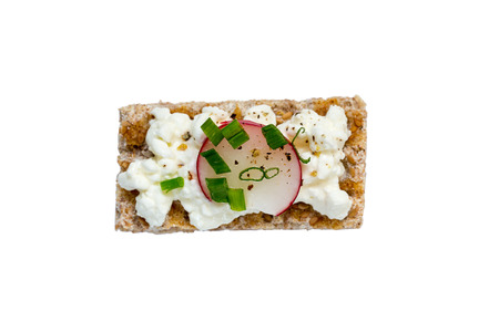crispbread: Crispbread isolated with cottage cheese radishes and chives. Stock Photo