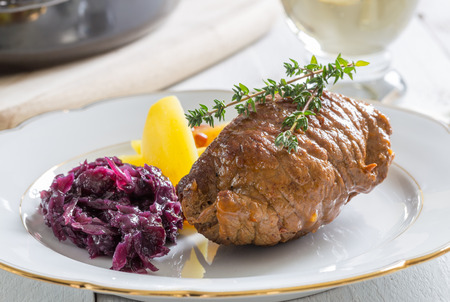 Roulade of beef with potatoes and red cabbage.