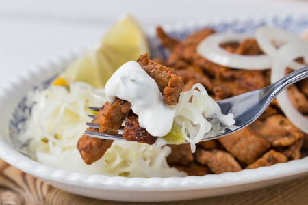 gyros: Gyros with Tzatziki Coleslaw olives and feta cheese.