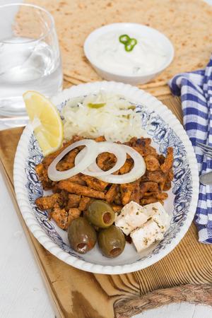tzatziki: Gyros with Tzatziki Coleslaw olives and feta cheese.