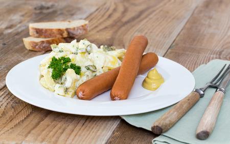 Potato salad with sausage and mustard.