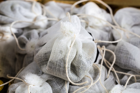 purring: Tea bag made of fabric in a box. Stock Photo