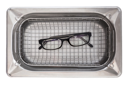 ultrasonic: Professional cleaning glasses with an ultrasonic cleaner. Stock Photo
