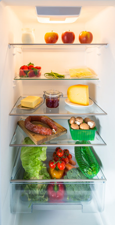 Open fridge filled with food. photo