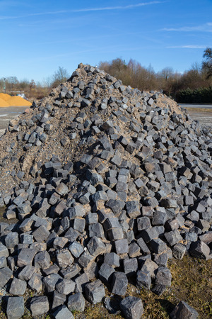 infrastructures: Cobblestone stored at a construction site.