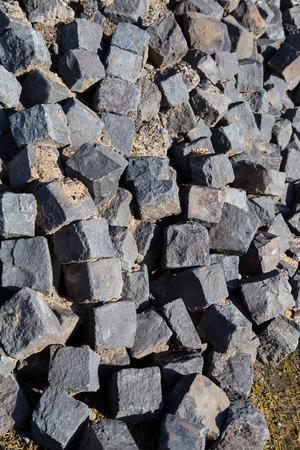 stored: Cobblestone stored at a construction site.