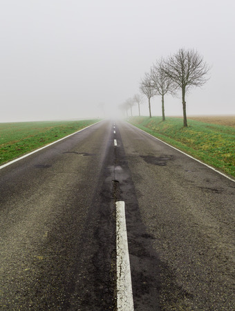 nothing: Road in fog leads to nothing.