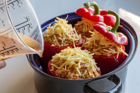 Stuffed peppers with meat sauce and cheese baked. photo