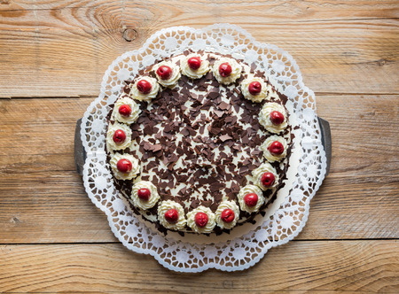 Black Forest cake on rustic wood.