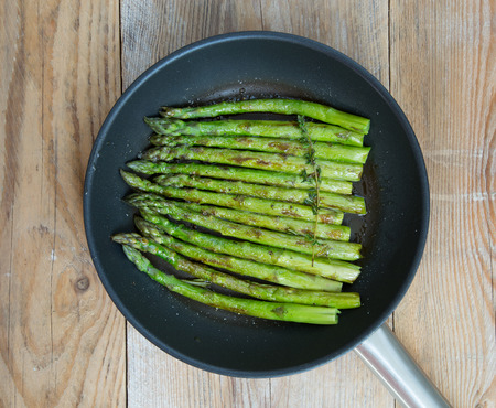covenant: Green asparagus is cooked in frying pan. Stock Photo