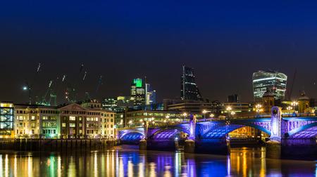 gentrification: London skyline at night. Stock Photo
