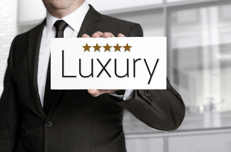 five star: Businessman holding five star luxury sign. Stock Photo