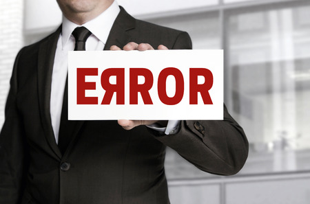 flaw: Error sign held by businessman.