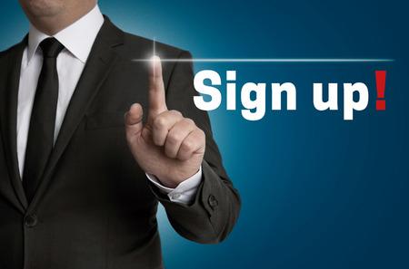 Registreren touchscreen wordt beheerd door zakenman. Stockfoto