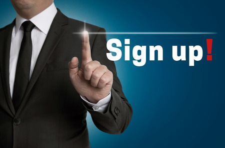 Sign up touchscreen is operated by businessman. Stock Photo