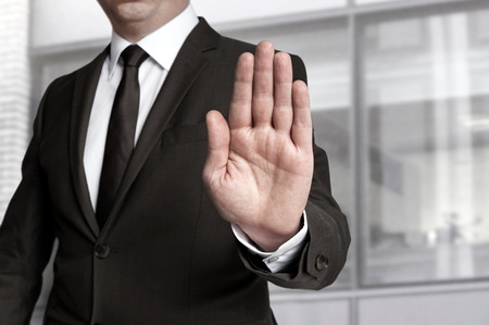 stop: Hand stop shown by businessman.