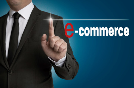 e commerce: e commerce touchscreen is operated by businessman.