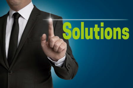 reestablishment: Solutions touchscreen is operated by businessman Stock Photo