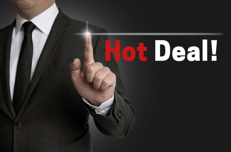 special offer: Hot Deal touchscreen is operated by businessman.