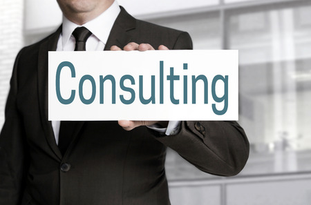 reestablishment: consulting sign is held by businessman. Stock Photo