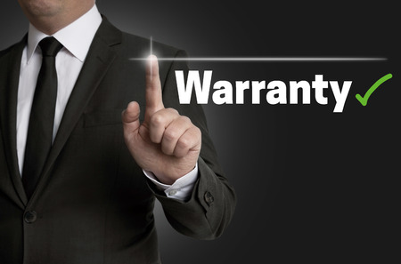 Warranty touchscreen is operated by businessman.