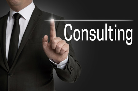 consulting touchscreen is operated by businessman.