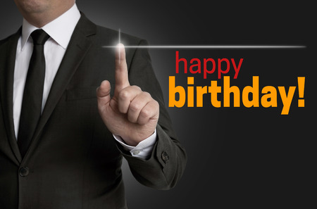 touchscreen: Happy Birthday touchscreen is operated by businessman.