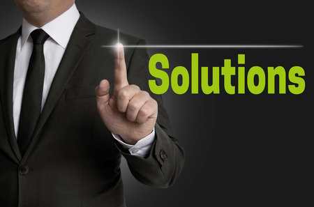 reestablishment: Solutions touchscreen is operated by businessman.