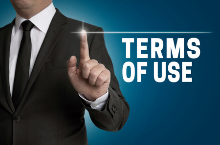 terms: Terms of use touchscreen is operated by businessman.