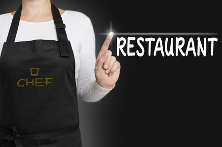 touchscreen: Restaurant touchscreen is operated by chef. Stock Photo
