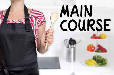 main course: Main course chef holding cooking spoon background. Stock Photo