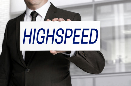 highspeed: Highspeed; sign is held by businessman.