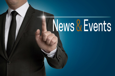 News and Events touchscreen is operated by businessman.